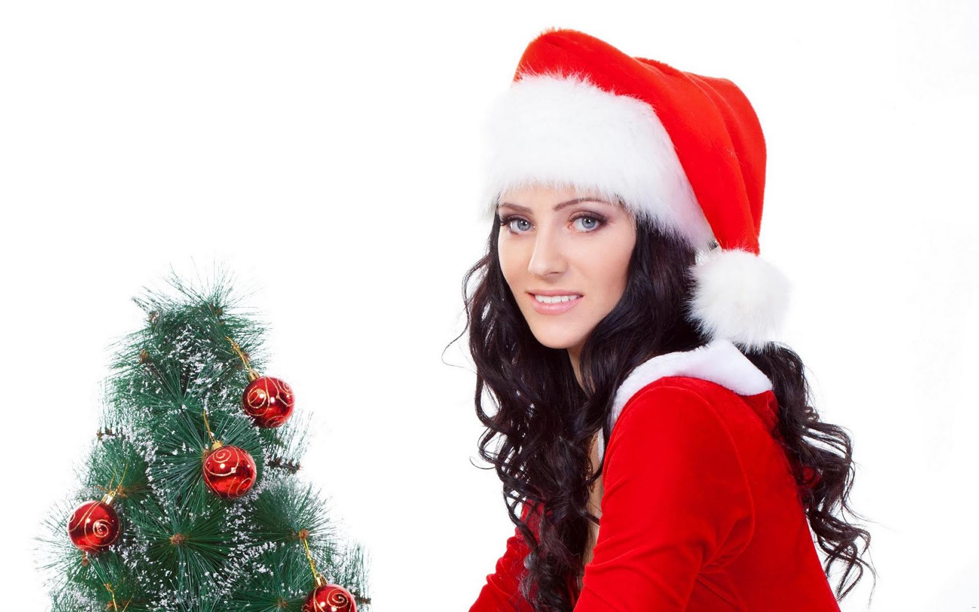 Wallpaper Chica Santa Claus decorando árbol
