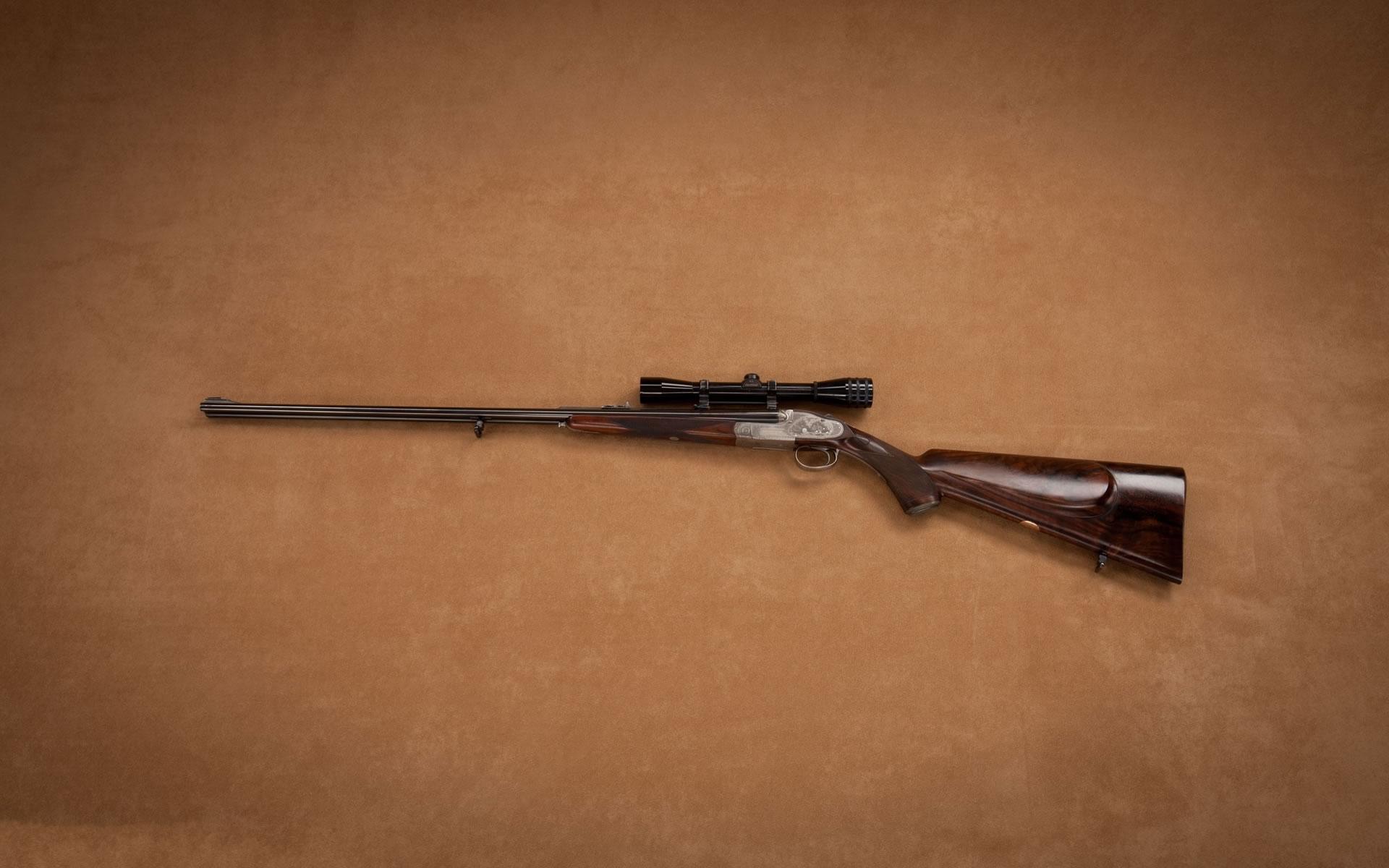 Wallpaper Rifle con mira telescópica.