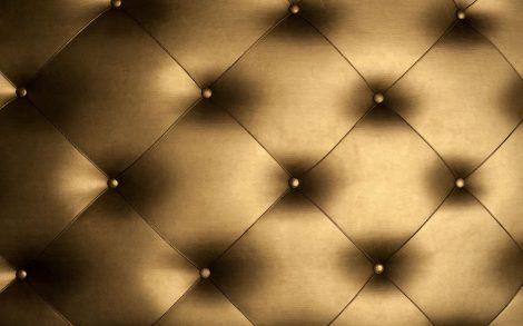 Tapizado dorado de sofá